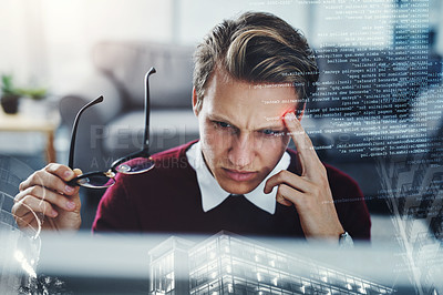 Buy stock photo Shot of a young businessman suffering from a headache at work