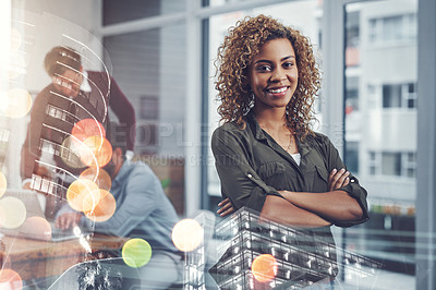 Buy stock photo Portrait of an attractive young businesswoman posing with her arms folded at work with her colleagues in the background