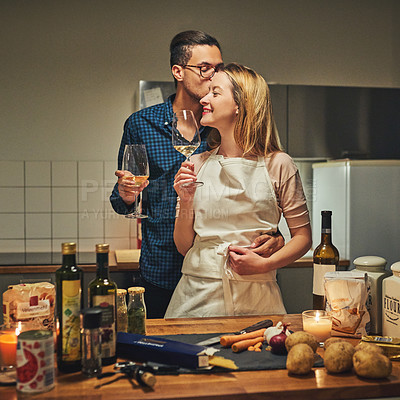 Buy stock photo Cropped shot of an affectionate couple standing together while cooking