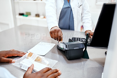 Buy stock photo Closeup shot of a pharmacist processing a credit card payment from a customer in a chemist