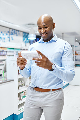 Buy stock photo Shot of a mature man looking at products in a pharmacy