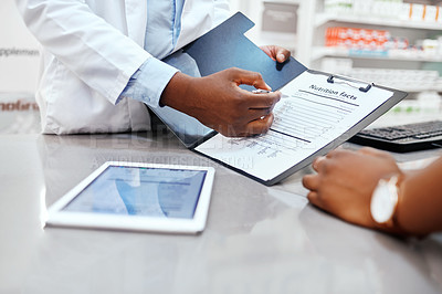 Buy stock photo Closeup shot of a pharmacist discussing nutritional facts with a customer in a chemist