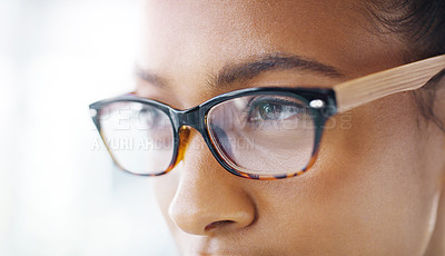 Buy stock photo Closeup shot of an attractive young businesswoman wearing spectacles in a modern office