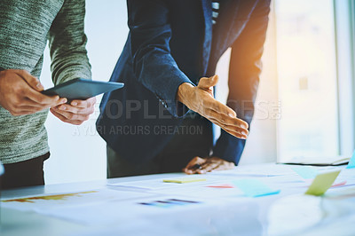 Buy stock photo Shot of two unrecognizable businessmen discussing ideas during a boardroom meeting at work