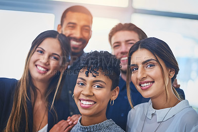 Buy stock photo Portrait of a cheerful group of young businesspeople smiling and posing together at work