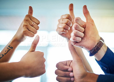 Buy stock photo Cropped shot of a group of unrecognizable colleagues showing thumbs up in an office