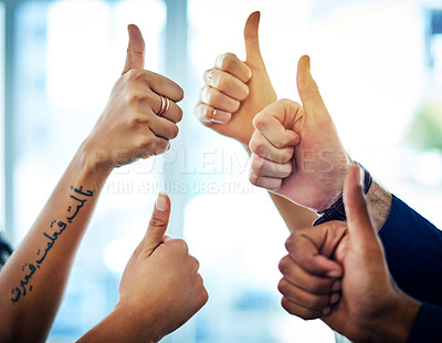Buy stock photo Cropped shot of  unrecognizable colleagues showing thumbs up in an office