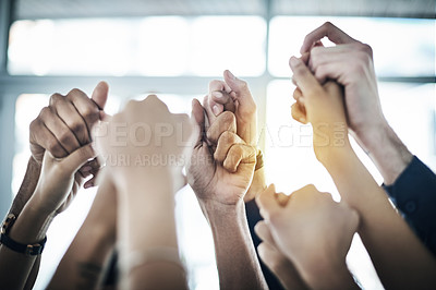 Buy stock photo Cropped shot of unrecognizable colleagues holding hands in unity