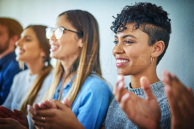 Buy stock photo Cropped shot of an attractive young businesswoman and her colleagues cheering during a presentation