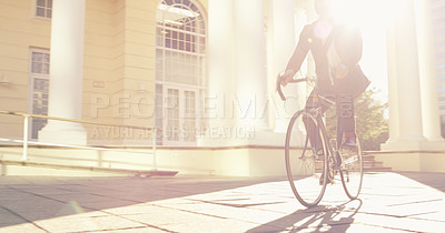 Buy stock photo Shot of an unrecognizable businessman commuting to work with his bicycle