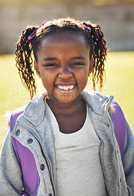 Buy stock photo Portrait of an elementary school girl standing outside