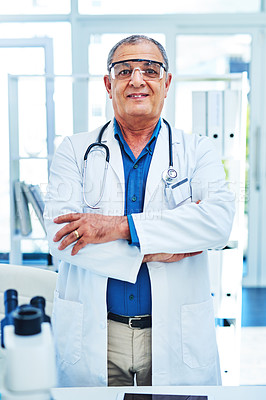 Buy stock photo Portrait of a mature scientist standing in a laboratory