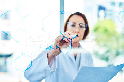 Buy stock photo Shot of a mature scientist drawing molecular structures on a glass wall in a laboratory