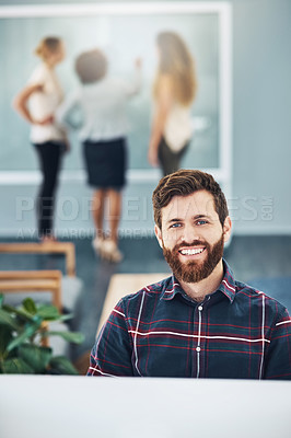 Buy stock photo Portrait of a young businessman working in an office with his colleagues in the background