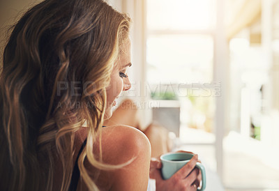 Buy stock photo Shot of a relaxed young woman having coffee at home
