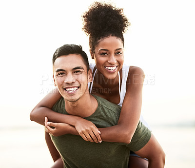 Buy stock photo Portrait of a young couple bonding together outdoors