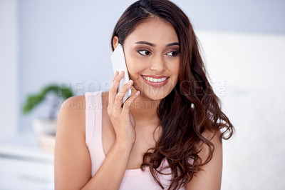 Buy stock photo Shot of a beautiful young woman using her smartphone in bed during the morning at home