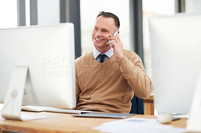 Buy stock photo Cropped shot of a businessman talking on the phone in the office