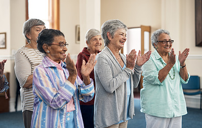 Buy stock photo Cropped shot of a group of senior woman applauding during a fitness class in their retirement home