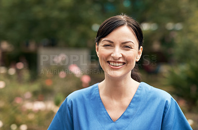 Buy stock photo Portrait of a beautiful medical practitioner standing outside