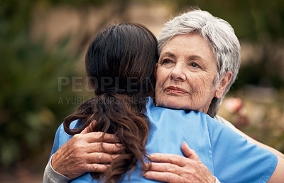 Buy stock photo Cropped shot of a senior woman embracing her caregiver