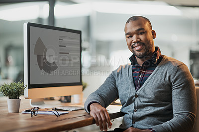 Buy stock photo Cropped shot of a handsome young businessman working in his office