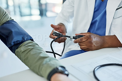 Buy stock photo Closeup shot of a doctor checking a patient's blood pressure