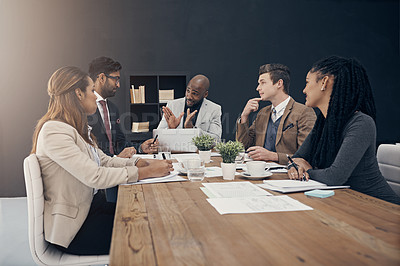 Buy stock photo Shot of a group of Shot of a group of young businesspeople having a meeting in a modern office having meeting at work