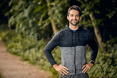 Buy stock photo Portrait of a sporty middle-aged man standing with his hands on his hips