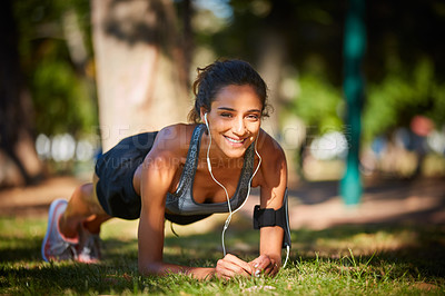 Buy stock photo Shot of a beautiful young woman exercising outdoors