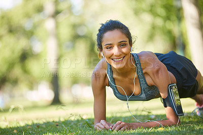 Buy stock photo Shot of a beautiful young woman exercising outdoors on a sunny day