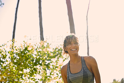 Buy stock photo Cropped shot of a sporty young woman standing outside on a sunny day