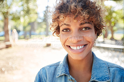 Buy stock photo Portrait of a beautiful young woman spending the day outdoors on a sunny day