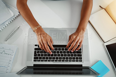 Buy stock photo High angle shot of a businesswoman working on a laptop in an office at night