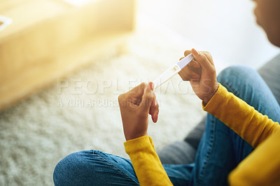 Buy stock photo Cropped shot of an unrecognizable woman taking a home pregnancy test