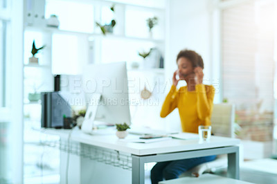 Buy stock photo Defocused shot of a young call centre agent working in an office