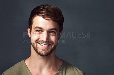 Buy stock photo Studio portrait of a handsome young man posing against a grey background
