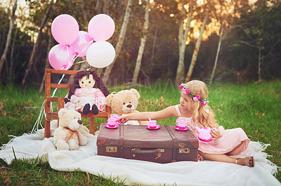 Buy stock photo Shot of an adorable little dressed as a princess having a teat party with her stuffed toys in the garden