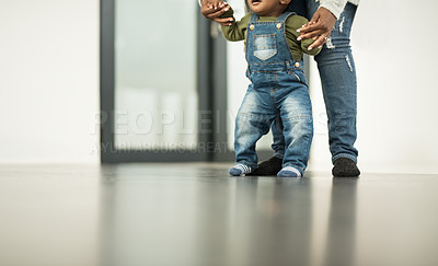 Buy stock photo Cropped shot of a mother teaching her baby boy to walk