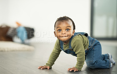 Buy stock photo Shot of an adorable baby boy crawling on the floor