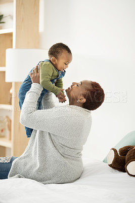 Buy stock photo Cropped shot of a mother playing with her adorable baby boy