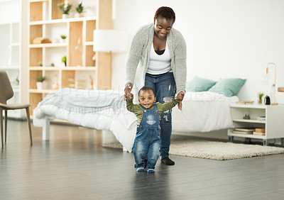 Buy stock photo Shot of a mother teaching her baby boy to walk