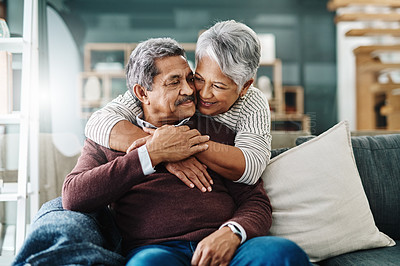 Buy stock photo Cropped shot of a cheerful elderly woman hugging her husband who's in a wheelchair at home during the day