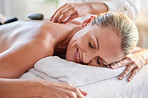 Break down sore muscles with a hot stone massage