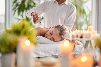 Buy stock photo Shot of a mature woman getting a back massage at a spa