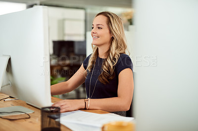Buy stock photo Cropped shot of a young businesswoman working in an office