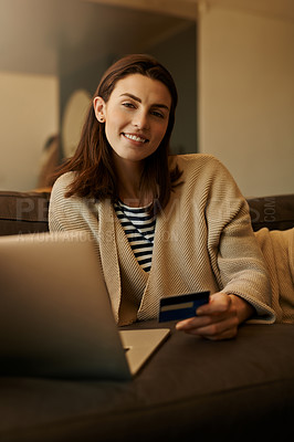 Buy stock photo Portrait of a beautiful young woman using a laptop and credit card at home