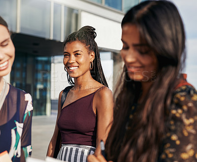 Buy stock photo Shot of a group of young women standing together outside on campus
