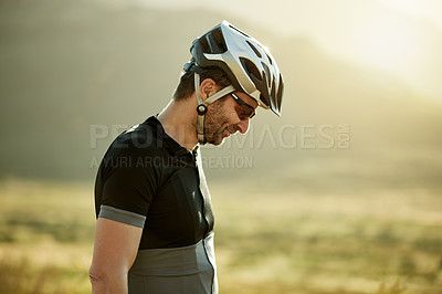 Buy stock photo Shot of a mature man out for a ride on his mountain bike