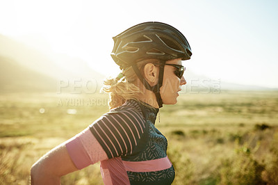 Buy stock photo Cropped shot of a sporty young woman out exercising